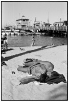 http://ed-templeton.com/files/gimgs/th-150_Couple lays on sand Avalon beach pier.jpg