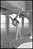 http://ed-templeton.com/files/gimgs/th-153_Girl balances on slackline HB pier V2.jpg