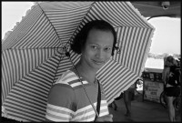 https://ed-templeton.com:443/files/gimgs/th-153_Asian Man under umbrella HB pier.jpg
