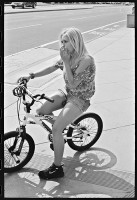 https://ed-templeton.com:443/files/gimgs/th-153_Girl on bike Teen Smoker HB.jpg